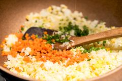 Cooking fried rice. On pan royalty free stock photo