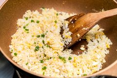 Cooking fried rice. On pan royalty free stock image