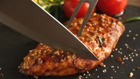 Cooking fried roasted chicken breasts cut knife with lemon tomato and rosemary mustard seeds honey stock video