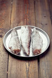 Cooking from frozen: frozen fish on a tray Stock Images