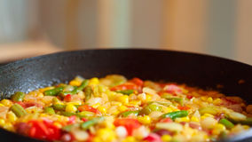 Cooking frozen vegetables in a pan Royalty Free Stock Images