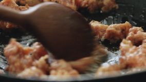 Cooking and frying sausage meat stock video footage