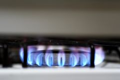 Cooking with Gas. A Gas cooktop alight Royalty Free Stock Photography