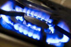 COOKING WITH GAS. Cas cooking ring with blue flames Royalty Free Stock Image