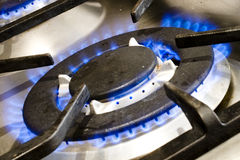 Cooking with gas. Cas cooking ring with blue flames Stock Photography