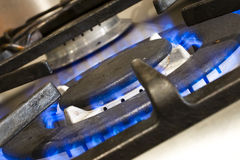 Cooking with gas. Cas cooking ring with blue flames Royalty Free Stock Photo