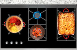 Cooking on a gas stove casserole and vegetables top view Stock Photography