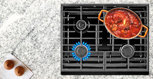 Cooking on gas stove Royalty Free Stock Image