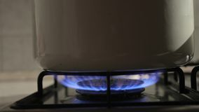Cooking on gas stove. Burner closeup, sliding camera stock video