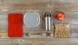 Cooking gear for hiking or camping on rustic wooden boards Royalty Free Stock Image