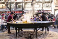 Cooking a giant Paella, traditional Valencian food Stock Images