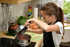 Cooking girl Royalty Free Stock Photo