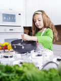 Cooking girl Royalty Free Stock Images