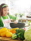 Cooking girl Stock Photography