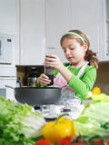 Cooking girl Royalty Free Stock Image