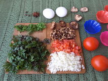 Cooking goutweed omelette with mushrooms shiitake. Tomato and onion royalty free stock photo