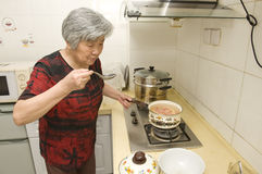 Cooking grandma Stock Image