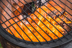 Cooking grate at a old fire pot with burning fire Royalty Free Stock Image