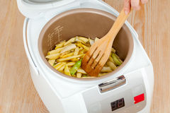 Cooking green beans in multicooker Royalty Free Stock Photo