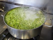 Cooking green beans. A school kitchen cooking green beans royalty free stock photos