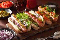 Cooking grilled hot dogs with vegetables ketchup mustard Stock Images