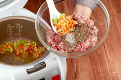 Cooking ground meat in multicooker Royalty Free Stock Photos