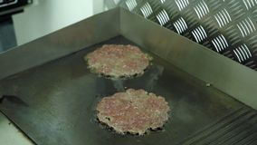Cooking hamburger patties. Chef turning meat in the pan. stock footage