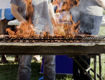 Cooking Hamburger patties on a grill Stock Photo