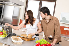 Cooking - happy couple in modern kitchen Royalty Free Stock Images