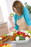 Cooking - Happy woman reading recipe from cookbook Stock Images