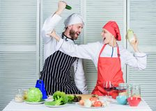 Cooking healthy food. Fresh vegetarian healthy food recipe. Join healthy lifestyle. Fresh vegetables. Vegetarian family. Woman and bearded men cooking together royalty free stock images
