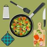 Cooking healthy vegan food on the kitchen table, ingredients and utensils. Pan with vegetables, knife, spatula, oven mitts, grater. Vector illustration royalty free illustration