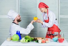 Cooking healthy. vegetarian. cook uniform. happy couple in love with healthy food. man and woman chef in restaurant royalty free stock photography