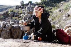 Cooking hiker woman Royalty Free Stock Photography