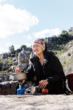 Cooking hiker woman Stock Images