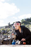 Cooking hiker woman Stock Photo