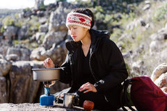 Cooking hiker woman Stock Image