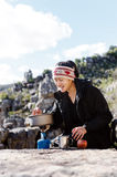 Cooking hiker woman Royalty Free Stock Photo