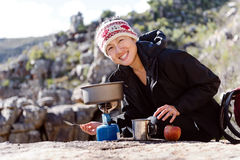 Cooking hiker woman Royalty Free Stock Images