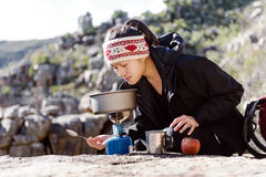 Cooking hiker woman Stock Photography