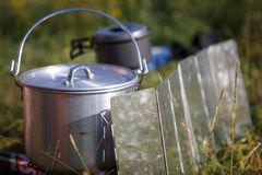 Cooking while Hiking on the burner in camping utensils stock photography