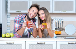 Cooking at home. Beautiful and romantic couple is cooking Stock Photography