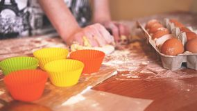 Cooking and home concept - close up of female hands kneading dough at home stock photo