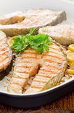 Cooking at home fresh salmon with lemon parsley Stock Images