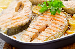 Cooking at home fresh salmon with lemon parsley Royalty Free Stock Image