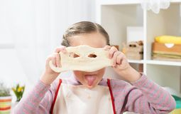 Cooking at home, girl in kitchen, making dough, healthy food concept Stock Image
