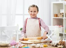 Cooking at home, girl in kitchen, making dough, healthy food concept Royalty Free Stock Photos