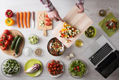Cooking at home with online recipes Royalty Free Stock Photo