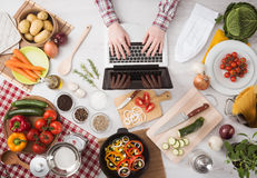 Cooking at home with online recipes Stock Photography