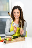Cooking at home. Young Woman Cooking. Healthy Food - Vegetable Salad. Diet. Dieting Concept. Healthy Lifestyle. Cooking At Home. Prepare Food royalty free stock photography